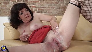 Mature mom Harrietta shaving her hairy bush
