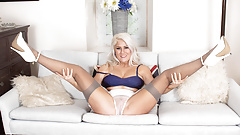 Horny blonde masturbates legs wide to juicy orgasm in nylons