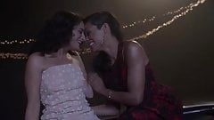 Rosario Dawson kissing Jenny Slate