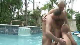 Bear and young men at the pool