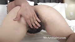 Lisandra puts on a sexy striptease in bed for us