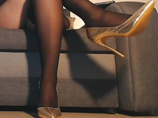 Pantyhose and stockings and legs Long legs in black pantyhose and heels
