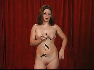Adult reactive attachment Full-figured brunette stands and attaches clamps to her own tits and pussy