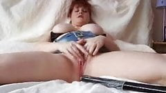 wife sticking a long long toy inside her