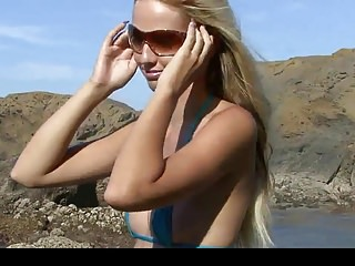 Beach micro bikini sex - Hot blonde in blue micro bikini posing and spreading legs