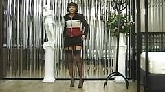 Sexy brunette with stockings and nice tits shows off her perfect ass and pussy