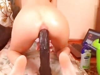 Taking huge dildo Cam slut takes a long huge dildo up her ass