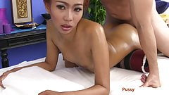 She gets oiled up and fucked on the massage table