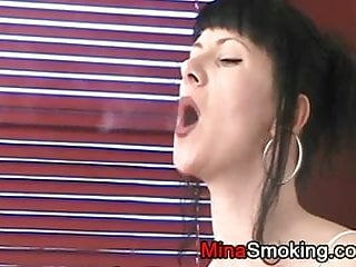 Lingerie and cigarettes Smoking a cigarette in lingerie