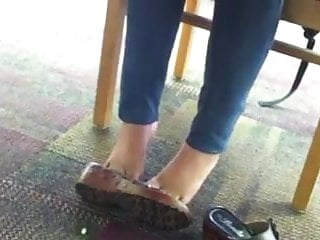 Alyssa placed her foot on jacks cock under table Cute teen feet under table