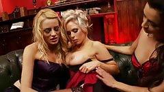 Three lesbians are entertaining on the sofa