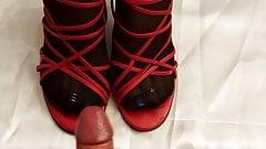 cumshot over her black nylon feet in red heels