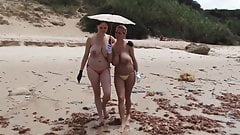 2 girls with great boobs are walking in the beach