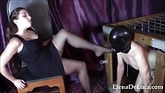 Domme Foot Fucks Mouth Of Caged And Hooded Naked male slave