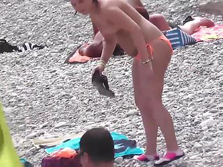 Video of teen with big boobs - Slim teen with big boobs on public beach orange swimsuit