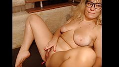 Woman in glasses caress herself and her pussy on camera