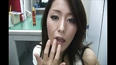 Sexy Asian milf in white sucks 2 cocks off at same time