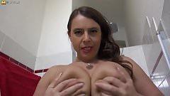 German MILF with big tits having fun in the bathroom