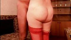 Snevla in red hotel room