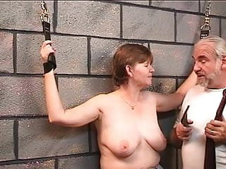Gay wrist band - Slave gets leather cuffs on her wrists and master puts a whip on her tits