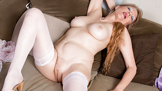 Blonde gilf Lilli pushes two fingers up her wet pussy