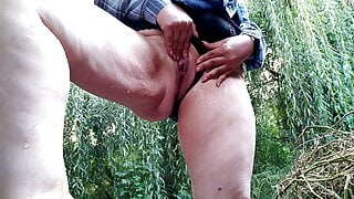 Milf in a short skirt masturbates and pisses while standing