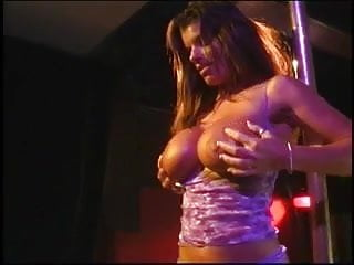 Sex acts on stage Two slutty lingered brunettes fuck each other with dildos on stage
