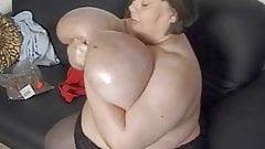Karola oiling her huge tits