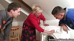 Two repairmen fuck old grandma from both ends