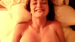 Sexy girlfriend takes a huge load to the face and smiles
