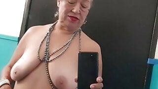 Pissing in a public bathroom. 67yo mature woman.