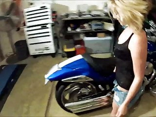 Vintage motorcycle models Little blonde needs help working on her motorcycle