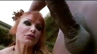 Redhead cougar sucks black cock