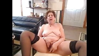 Hot breasted granny masturbating on cam