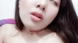 Sexy Asian cutie cumming on camera