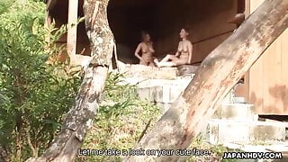 Asian cutties sucking on a dude at a spring