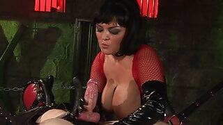 Chained man has a brunette mistress riding him in a dungeon