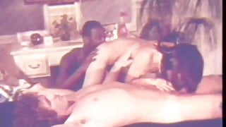 Juicy Interracial Threesome on Massage Table (1970s Vintage)