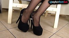 Stunning redhead wears pantyhose and shows off legs and feet