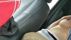 Husband films wife and friend in back seat