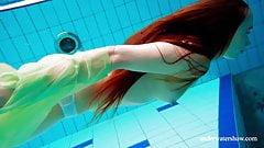 Hairy teen babe Nina Mohnatka swims in the pool