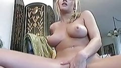 Busty Lisa Neils masturbates her pussy using her favorite to
