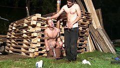 Bound boy made to suck cock outdoors