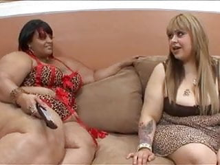 Wet pussies vids - Busty black whores sit on the couch and play with their tight wet pussies