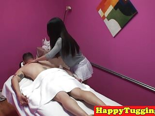 My asian masseuse - Asian masseuse tugging and fucking client