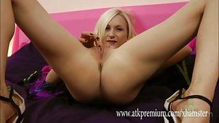 Blonde Sophie, sticks a dildo up her pussy