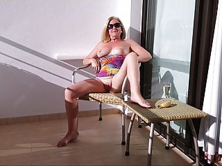 Practicing blowjob on a banana picture Debbie on a hotel balcony with a banana in her pussy