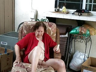 Pure adult lounge - Granny fucking vibrator on lounge in patio