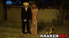 Submissive MILF on the street with man with a pig mask