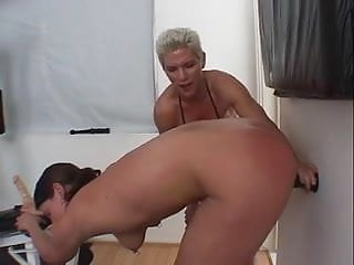 Lesbian musturbation - Muscular dyke fucks submissive chick with strap on during work out